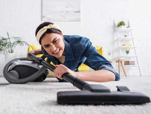 Frustrated Woman Vacuuming