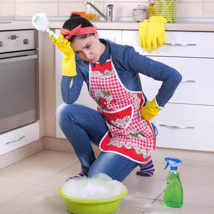 Woman Scrubbing Tile Floor